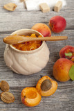 jar with jam and fresh apricots