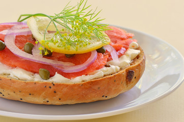 Smoked salmon lox on poppy seed onion bagel