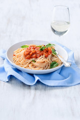 Pasta meal with glass of wine