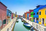 Venice landmark, Burano island canal, houses and boats, Italy