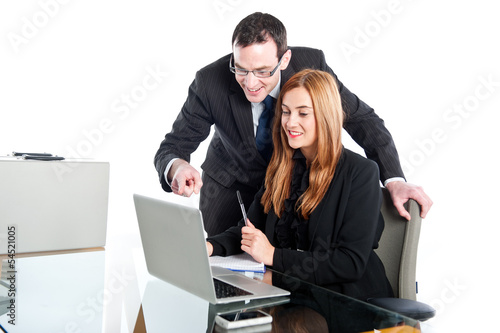 Young business people working on laptop
