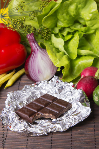 vegetables and chocolate on wood