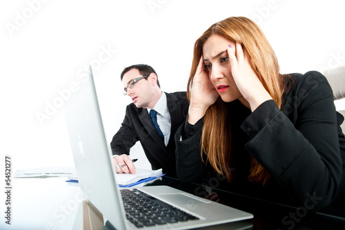 Two colleagues looking stressed whilst at work