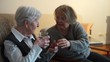 90 year old lady drinking a glass of water with caretaker
