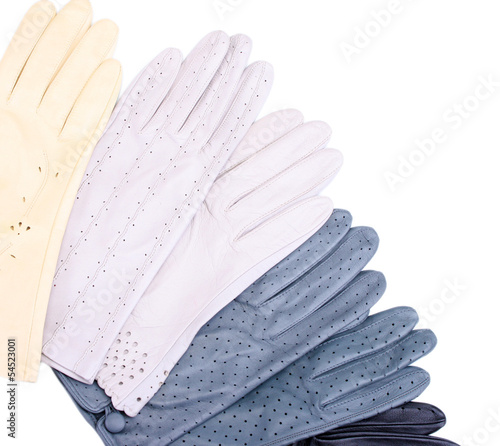 lot of beautiful women leather gloves isolated on white