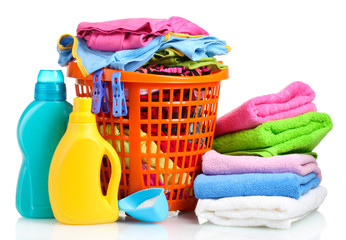 Clothes with detergent and washing powder in orange plastic