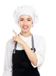 Chef woman in white uniform and hat pointing up