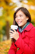 Coffee drinking woman in Autumn fall enjoying fall