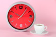 Cup coffee and clock on pink background