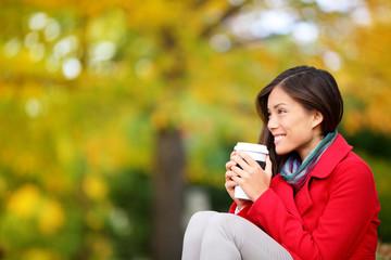 Autumn / fall woman drinking coffee looking