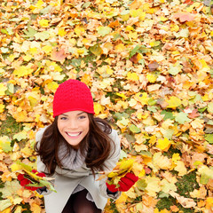 Autumn / Fall leaves background with woman happy
