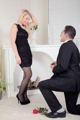 Man proposing kneeling on the floor