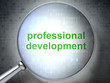 Education concept: Professional Development with optical glass