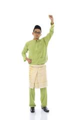 malay male jumping celebrating hari raya eid fitr after ramadan