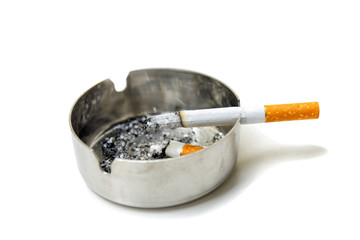 Cigarette and ashtray partially isolated on white