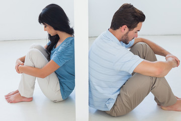 Sitting couple are separated by white wall
