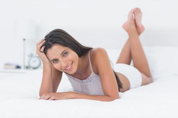 Beautiful woman relaxing lying in bed