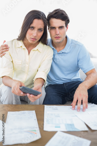Worried couple doing their accounts