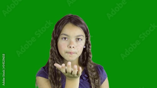 girl sends kisses on green screen