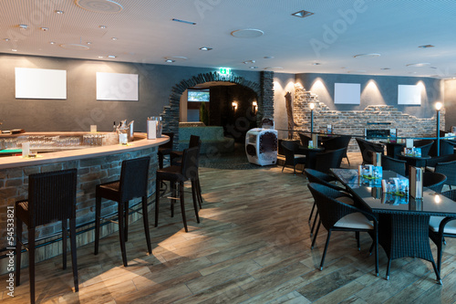 lounge bar in restaurant with white picture frames