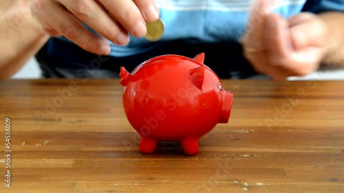 man filling money box