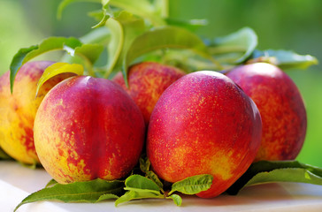 Ripe peaches on table