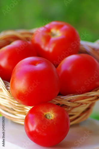 Ripe tomatoes on basket