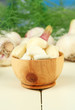 Fresh garlic on wooden table, on bright background