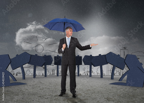 Businessman showing signs and a city