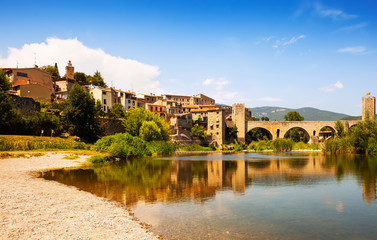 Old  town with antique bridge over  river. Besalu