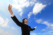 Business man carefree outstretched arms