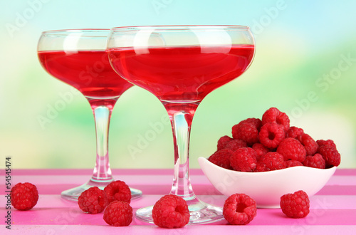 Jelly with fresh berries on pink wooden table