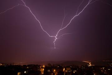 Beautiful powerful lightning over city