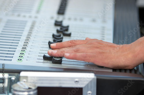 Man working on soundboard