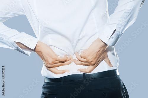 Leinwanddruck Bild Man with dorsal pain