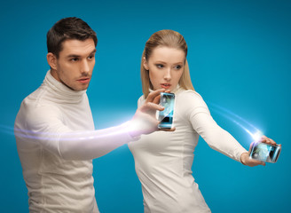 futuristic man and woman working with gadgets