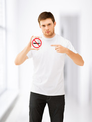 young man pointing at no smoking sign