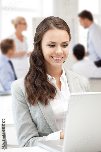 businesswoman with laptop computer at work