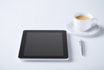 tablet pc with cup of coffee