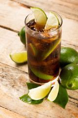 cocktail with cola ice cubes and lime