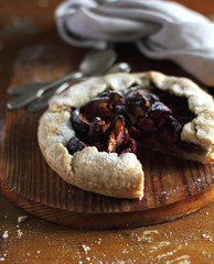 Piece of fruit pie or galette with figs and raspberry