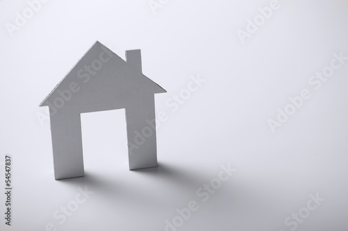 white paper house over white background