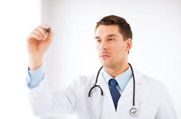 young doctor working with something imaginary