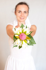 Beautiful bride showing her bouquet