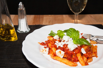 Penne and tomato sauce, with cheese and basil.