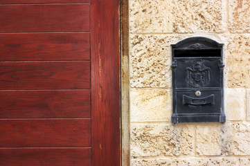 Old metal mail box with a wooden door