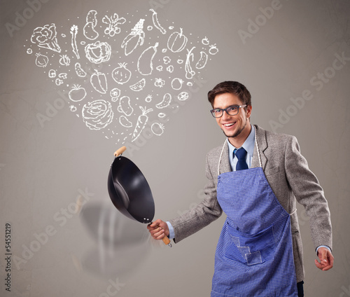 Attractive man cooking vegetables