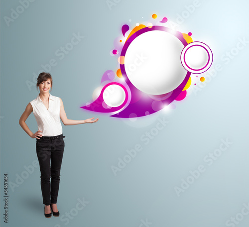 Attractive woman presenting abstract speech bubble copy space