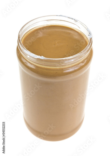 Opened jar of peanut butter on white background