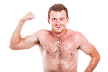 Happy sportsman showing biceps